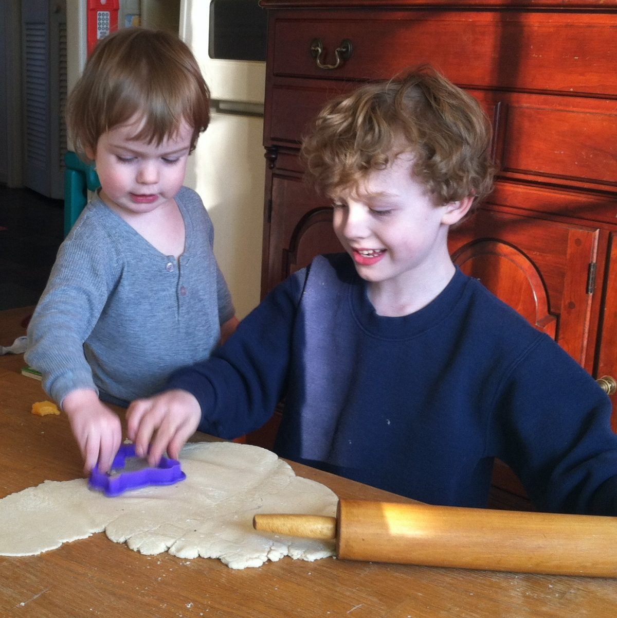 Brothers playing play dough