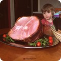 child with honeybaked ham for Easter (Sponsored)