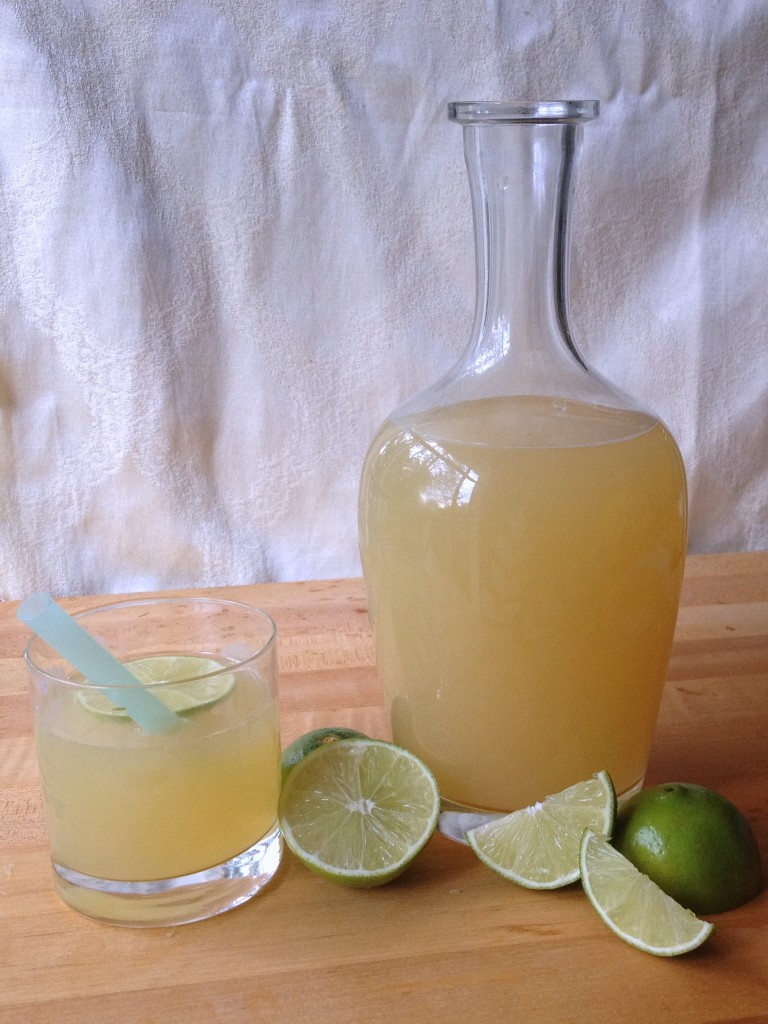 Fizzy Honey Limeade Recipe looks nice in a carafe on your buffet Joy Makin Mamas