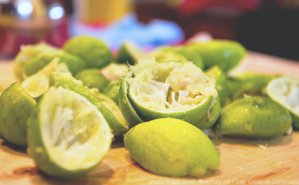 Juiced limes for Fizzy Honey Limeade recipe Joy Makin Mamas